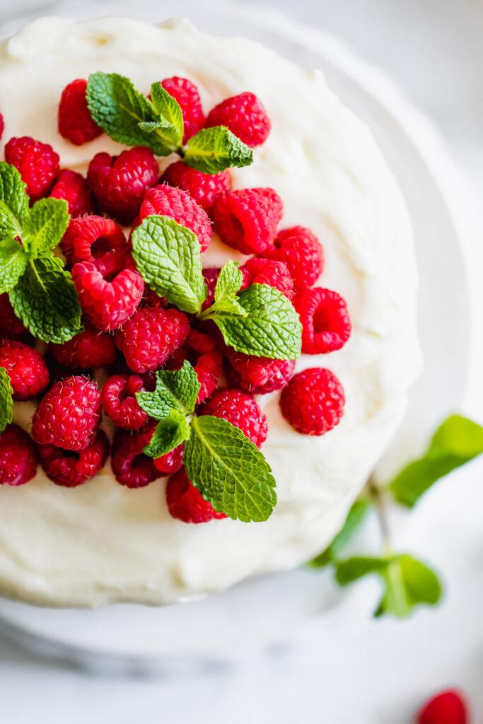 close up raspberries on cake