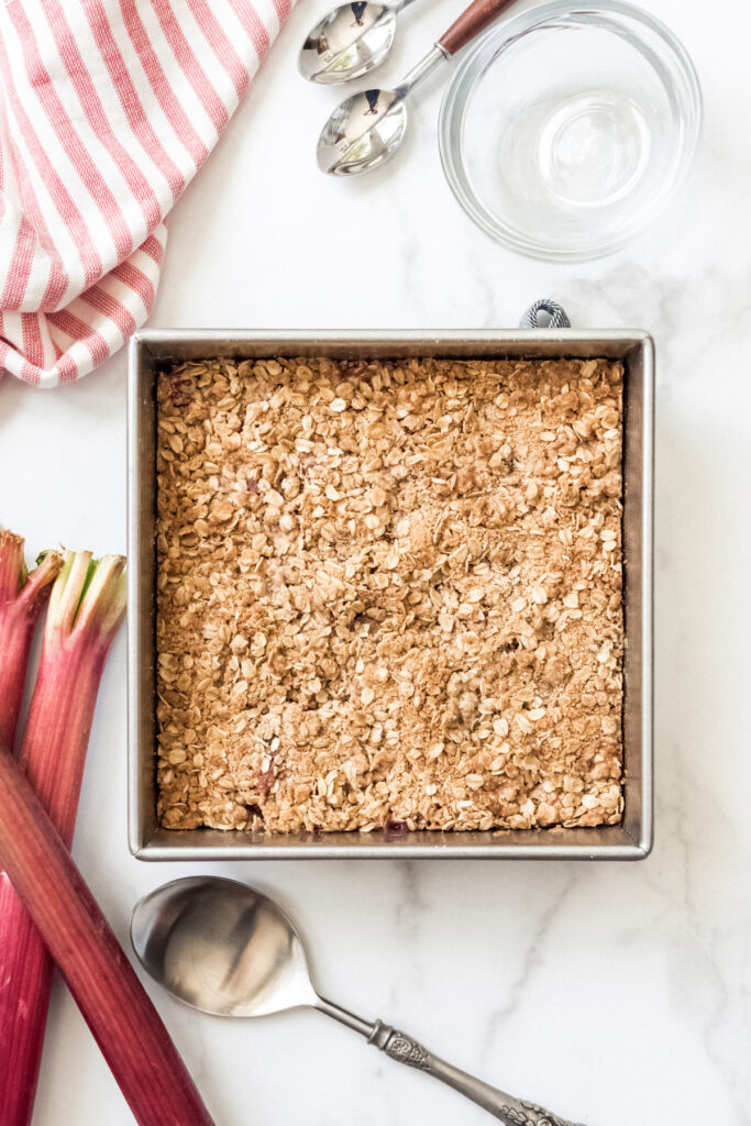 A square baking dish filled with rhubarb crisp.
