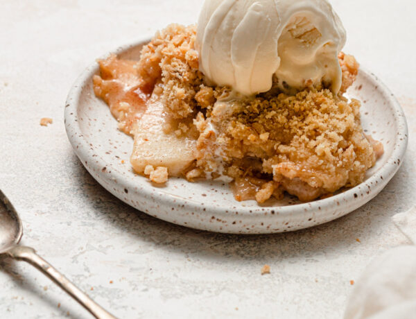 apple crisp on white plate with ice cream