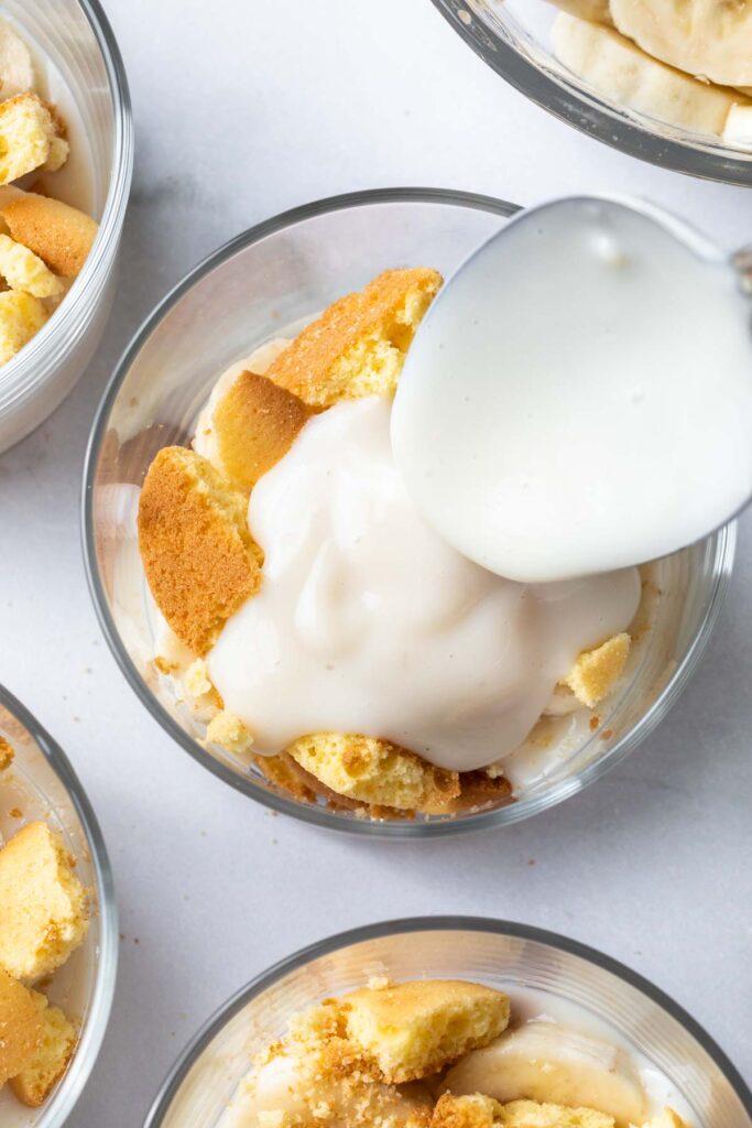 spooning pudding onto nilla wafers