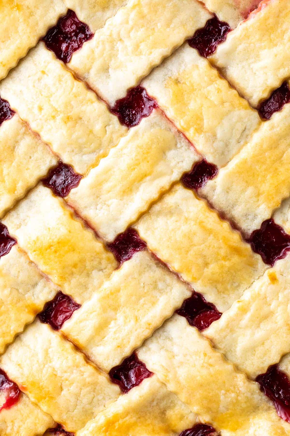 closeup of lattice pie crust for cherry pie