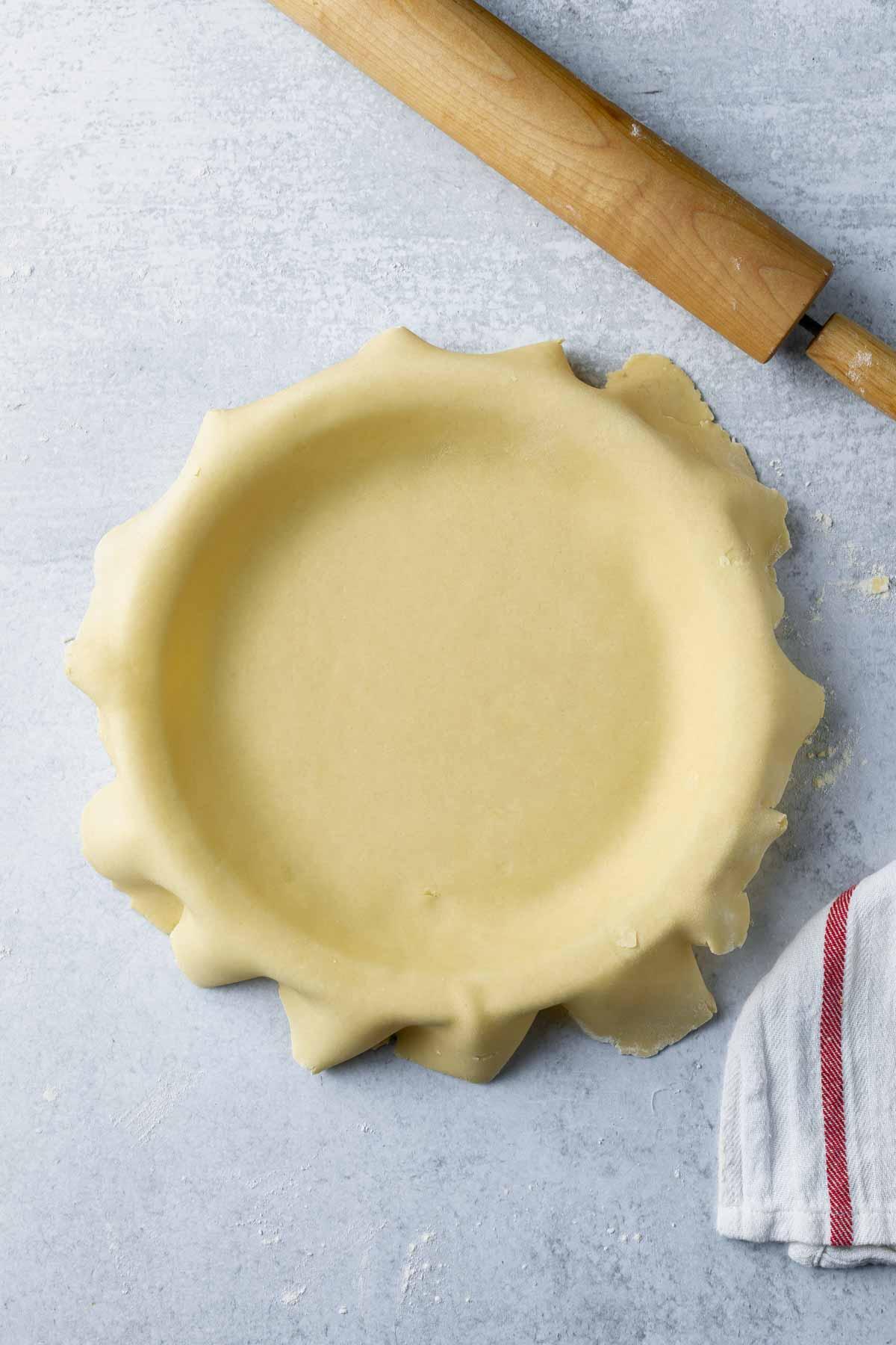 untrimmed pie crust in a pie plate