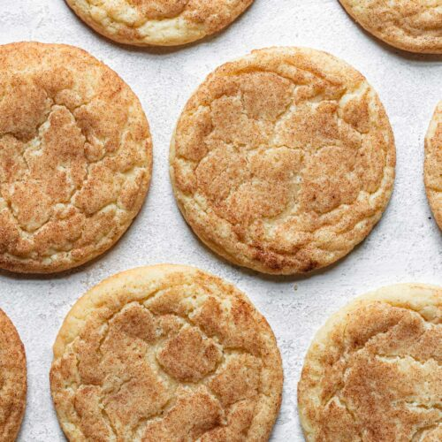 snickerdoodle cookies laying flat on board