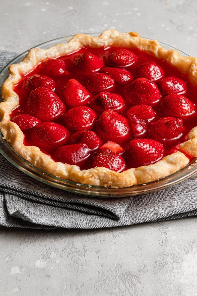set strawberry pie on grey napkin