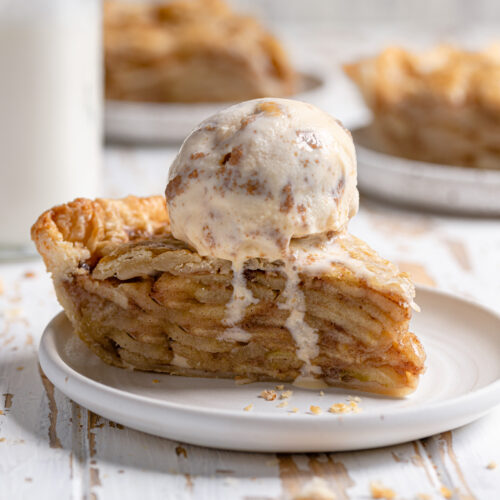 slice of apple pie with melting ice cream on top