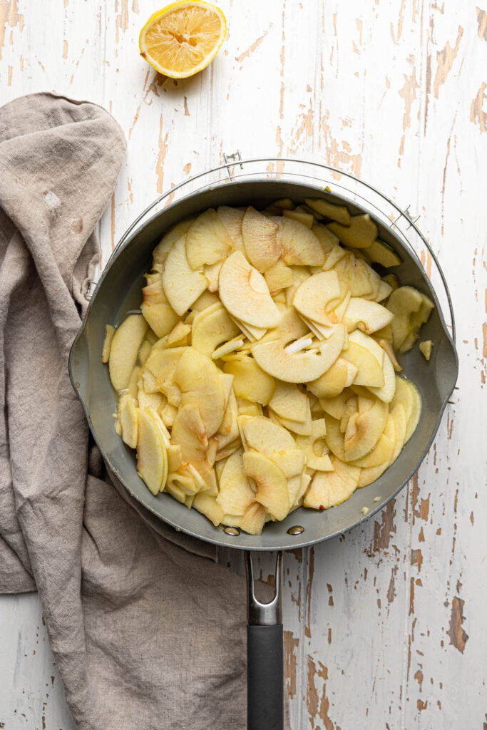 sliced apples with sugar, lemon juice and cinnamon in bowl
