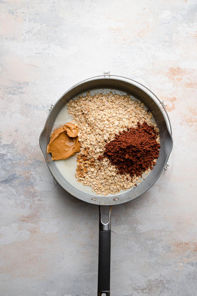 oats, cocoa and peanut butter in pot