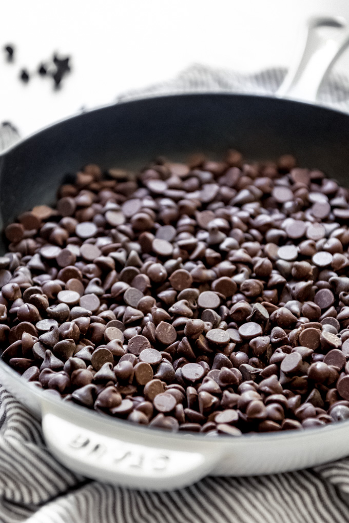 Chocolate chips in a cast iron skillet.