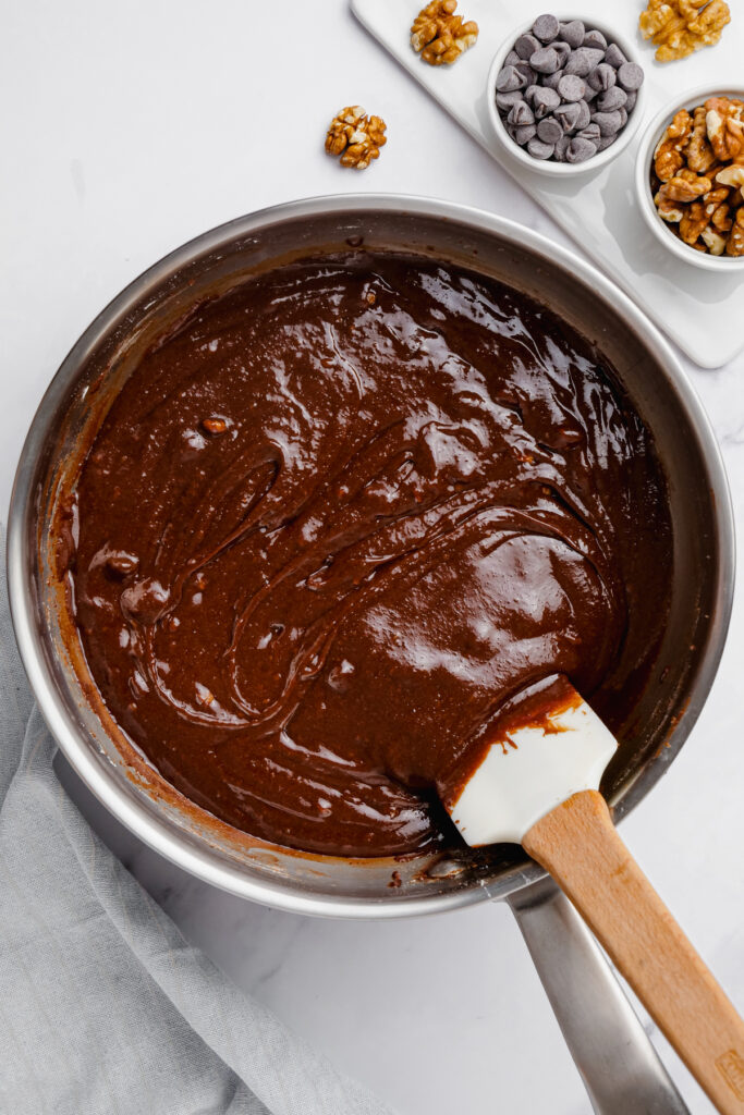 stirring brownie batter in pot
