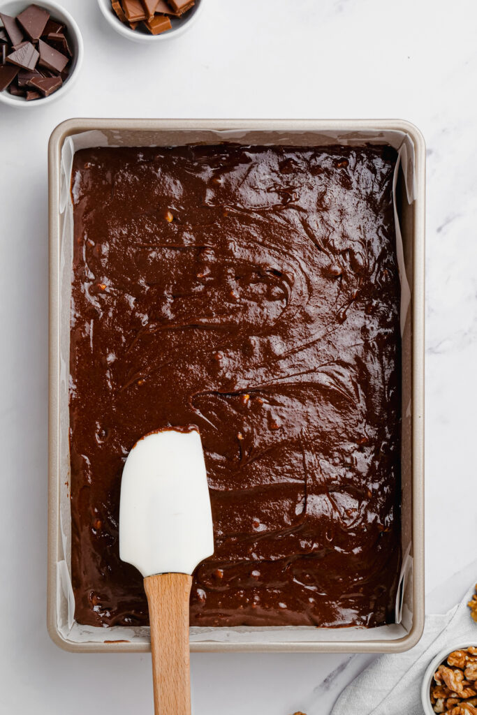 spreading brownie batter in pan