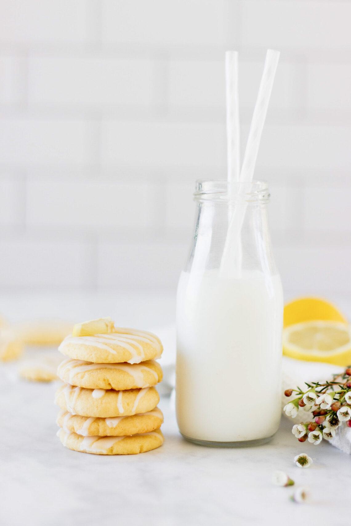 stack of lemon cookies with milk