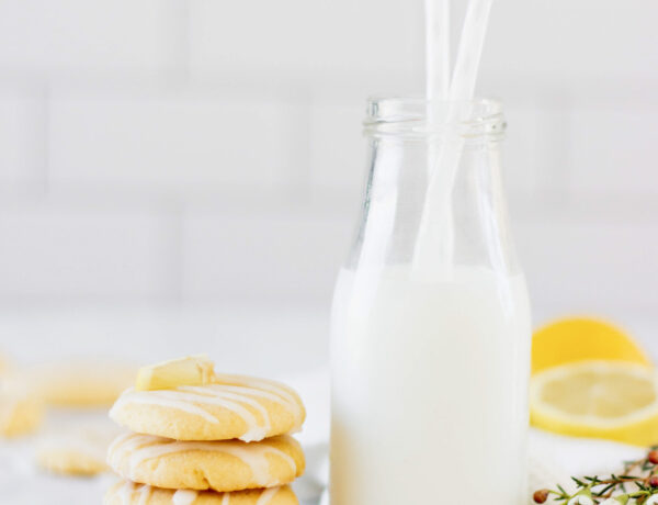 stack of lemon cookies with milk