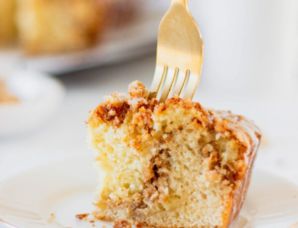 fork in piece of cinnamon streusel coffee cake