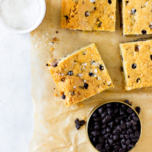 chocolate chip cookie bars on brown parchment paper