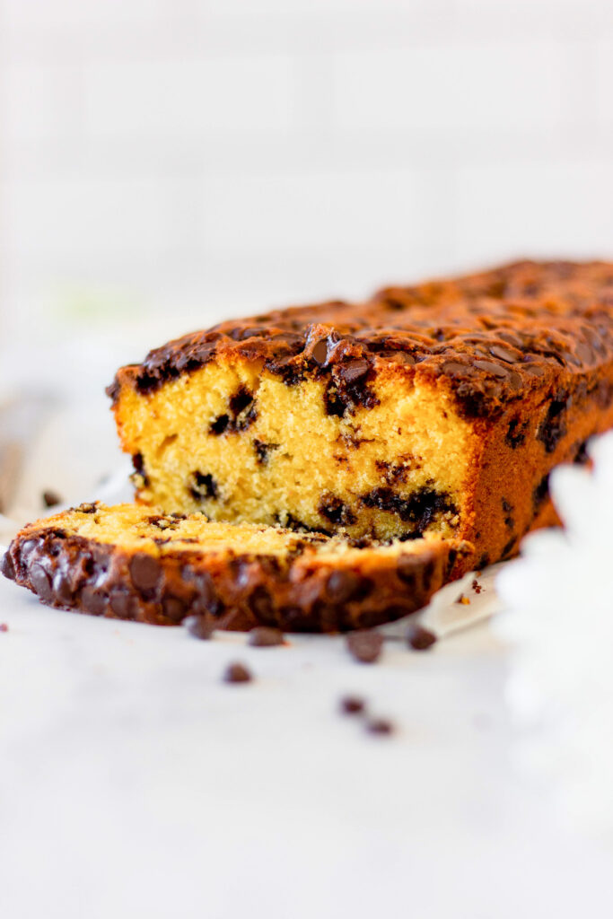 slice and loaf of pumpkin chocolate chip bread