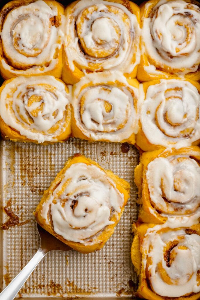 pumpkin cinnamon rolls in a baking pan