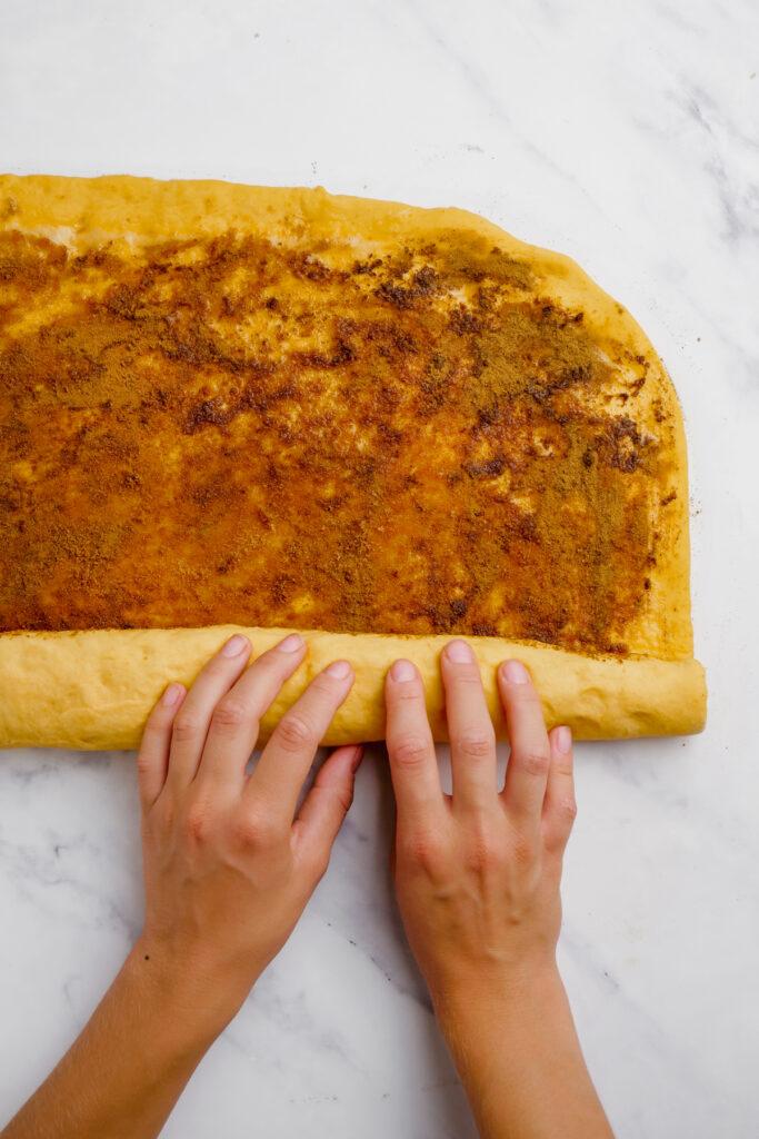 rolling cinnamon roll dough