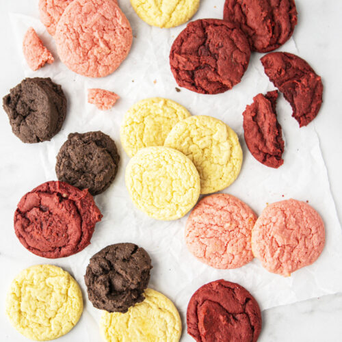 four different cake mix cookies on a counter