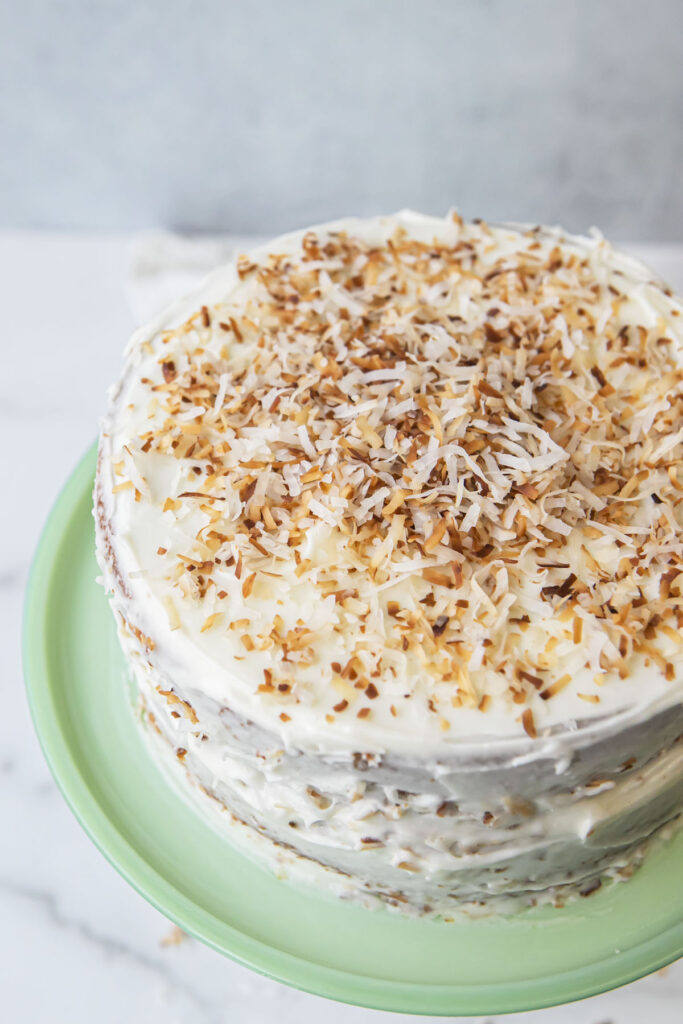 top of coconut cake with toasted coconut shreds