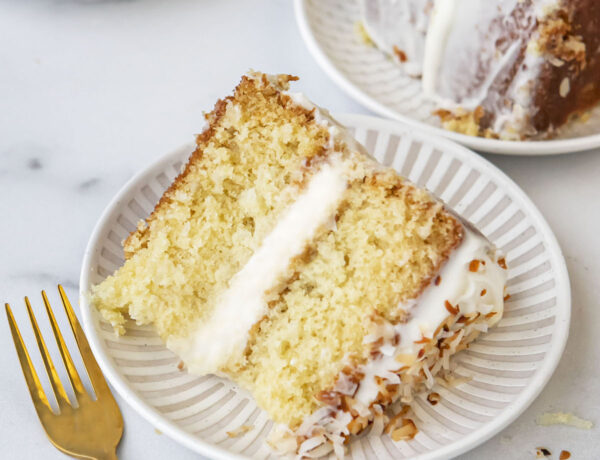 slices of coconut cake on plates