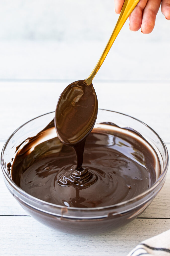 stirring melted chocolate with a spoon