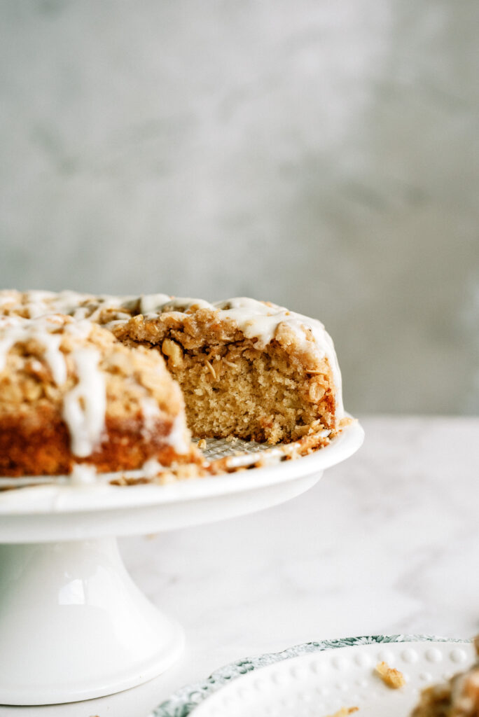 side view of apple crumble cake with a slice taken out of it