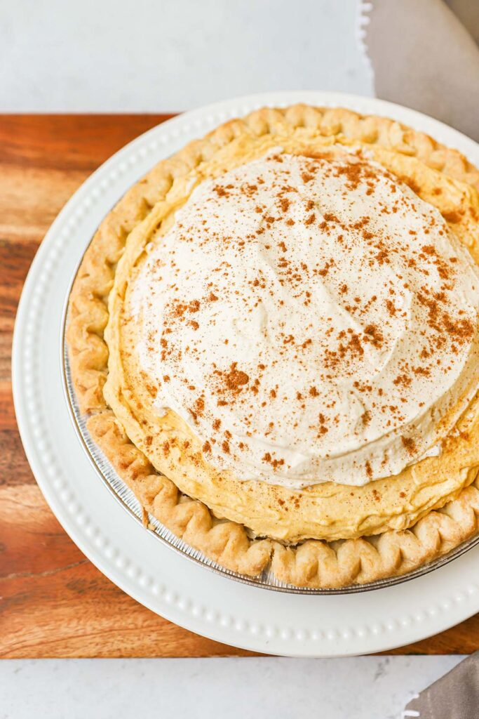 Pumpkin cream pie in a pie plate